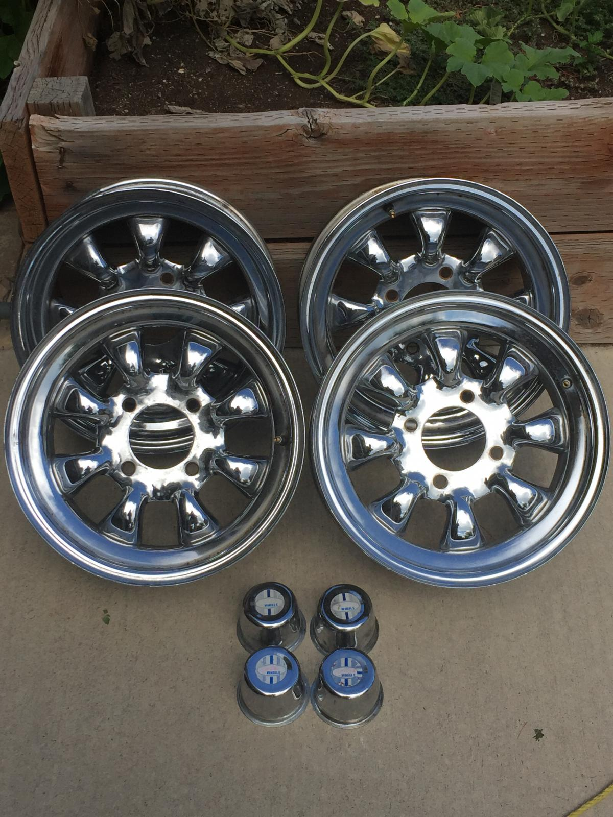8 spoked Smiths Wheels. Set of 4 with Caps