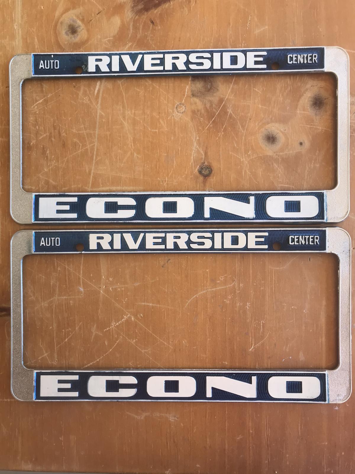 Original late NOS Empi license plate frames