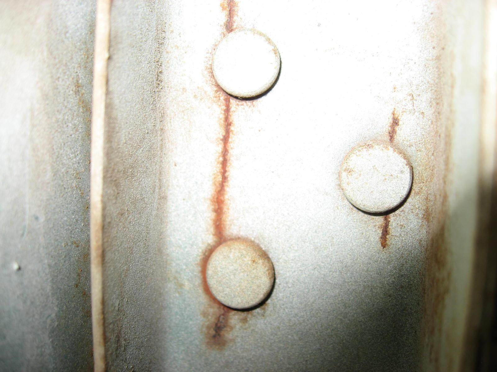 crack at lower hinge and patch weld