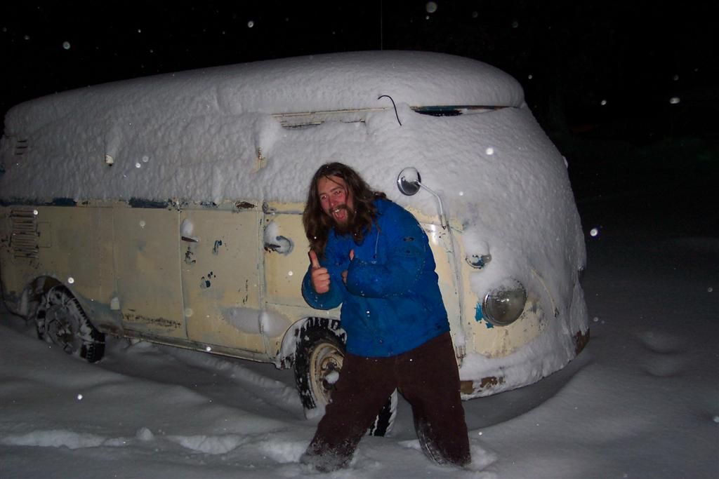 a drunk nate posing in front of his panel in mt shasta