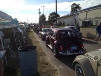 Show cars lining up to get in.