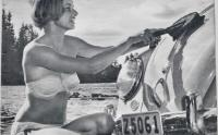 Vintage photo - Woman washing Beetle