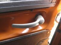 Handle at rear of sliding door.
