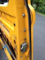 Late bay door bracket