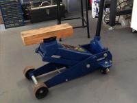 Floor jack with block of wood