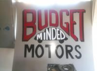 budget minded motors hand painted sign