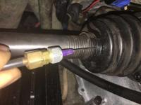 needle greasing axle boots