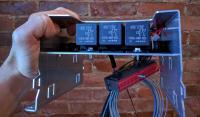 Bostig RG6 SK-W: Bostig circuit board installed in wiring bracket