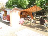 SO-23 with orange and white tent