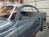 1959 Dolphin Blue Seat windows installed