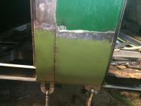 Fitting and welding rocker behind cargo door.