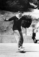Katherine Hepburn skateboarding 21 window bus in backgropund