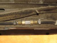 Check valve in fuel return line to prevent flow in case of a fuel leak or fire