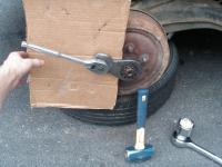 using slug wrench to loosen rear castle nut