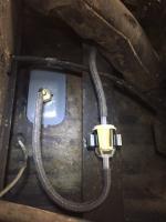 Fuel filter bracket underneath truck
