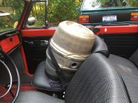Transporting an old beer keg.