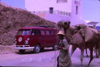 1964 Ruby Red Kombi Westy Rack Slash Bumper Innie Vent Push Button Middle East Camel Sandler & Travis Advisory Services