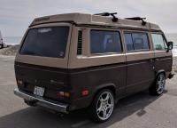 Vanagon with Porsche Lobster Claw wheels