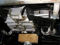 Jack under rear transaxle mount.
