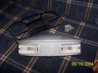 Combination reversing and number plate light
