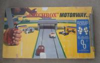 Matchbox motorway track with VW Bus camper on cover
