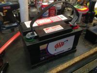 Battery lift strap