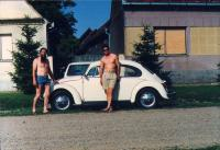 Late-model Beetle and 2 guys