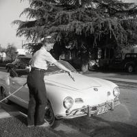 Lady washing and detailing her Ghia in CA