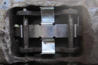 modified front caliper spring plates