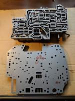 Valve body separation plate, transfer plate