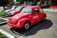 Drive a mexican Beetle and drink Coca Cola