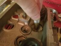 Broken valve guide boss