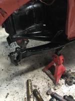 Front suspension stiffener