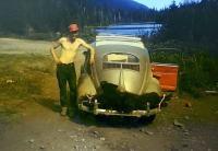 Oval window with bear on rear bumper