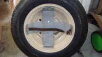 Holder for gas tank in spare wheel