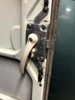 Door latch, interior panel and mystery piece