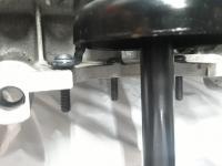 Sump bolt solution