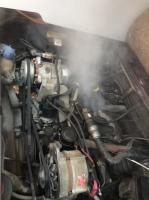 Coolant leak near thermostat housing