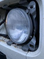 Round headlight- bracket?