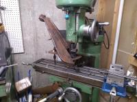 Reinforced IRS arm bearing bore machining