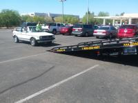 Cabriolet getting towed