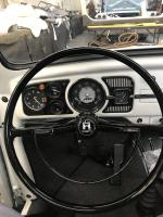 Aftermarket black steering wheel with black chrome horn ring