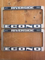 Original late NOS Empi license plate frames