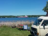 VWs camping on seaway with frieghter