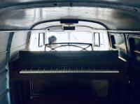 1960 panel with upright piano in back