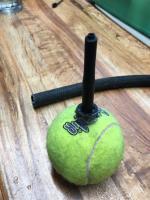 Tennis ball trick stabilizer