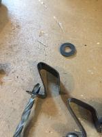Hub cap clip and rivet installation