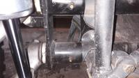 front beam showing set screw holding bushing in place
