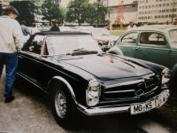 Ragtop next to Mercedes