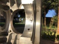 Aluminum case spun main bearing